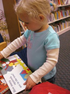 Bella reading at age 2.